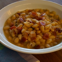 Beer-Baked White Beans with Bacon and Rosemary